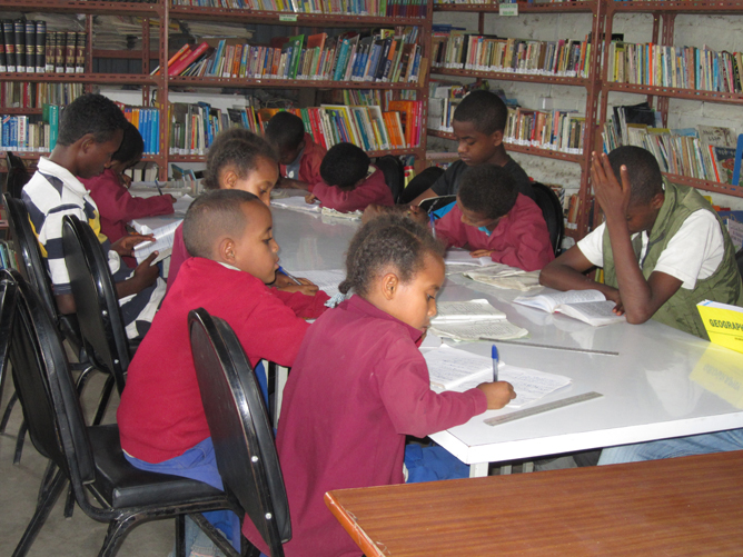 Kids studying in the library